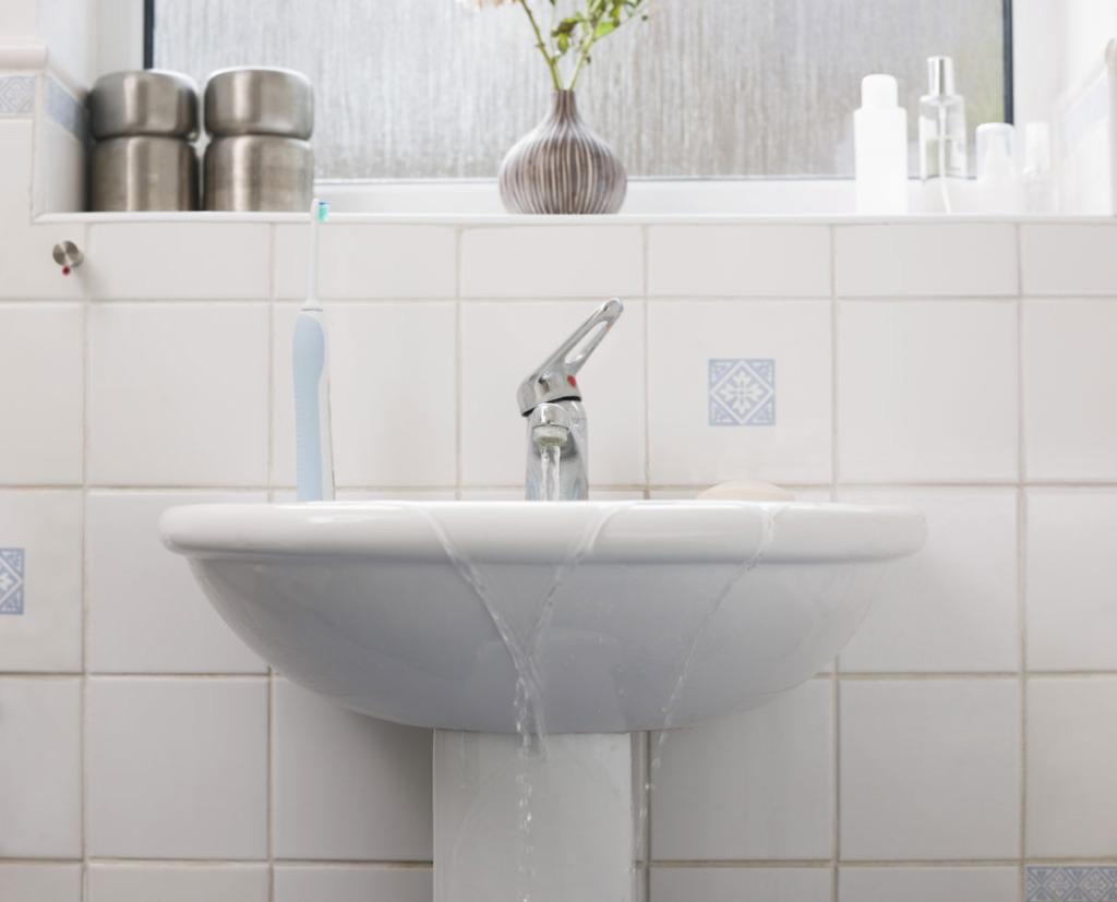 Overflowing-sink-in-bathroom
